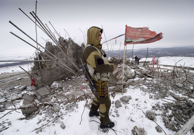 A Donestk People's Republic (RDN) looks on December 7, 2014 at the damaged Savur Mogila monument to Red Army soldiers fallen during World War II near the eastern Ukrainian city of Snizhnee before a ceremony, organized by the RDN, in memory of the pro-Russian rebels who have died during fighting against the Ukranian Army. (Eric Feferberg/AFP/Getty Images)