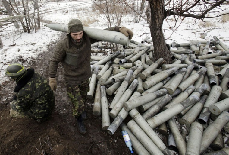 A Ukrainian artilleryman carries a shell past spent shell cases at their position near the eastern Ukrainian village Pisky, Donetsk region to be fired at the position of pro-Russian separatists at Donetsk airport on December 8, 2014. Ukraine and pro-Russian insurgents prepared Monday for their first comprehensive truce talks in three months aimed at calming an upsurge of violence that has further eroded trust between Moscow and the West. (Anatoli Stephanov/AFP/Getty Images)