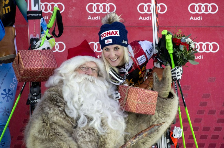 3rd placed Austria's Eva-Maria Brem (R) poses with a man dressed as Santa after the FIS Ski World Cup women's giant slalom in Are, Sweden, on December 12, 2014. A Man dressed as Santa Claus posed in the foreground. (Marcus Ericsson/AFP/Getty Images)