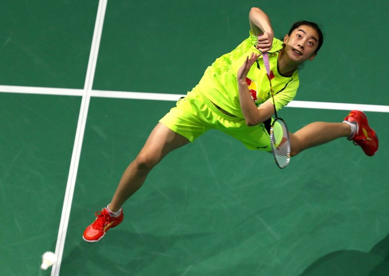 Badminton player Wang Shixian of China plays a shot to Sung Ji Hyun of Korea during the women's singles match at the BWF Destination Dubai World Superseries Finals at Hamdan Sports Complex in Dubai on December 19.  || CREDIT: MARWAN NAAMANI - AFP/GETTY IMAGES