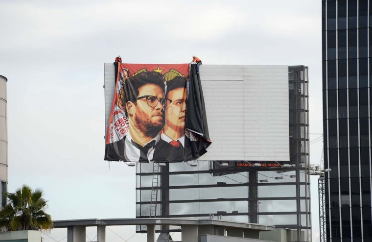 "Workers remove a poster-banner for ""The Interview"" from a billboard in Hollywood, California, December 18 a day after Sony announced it had no choice but to cancel the movie's Christmas release and pull it from theaters due to a credible threat.  Sony defended itself Thursday against a flood of criticism for canceling the movie which angered North Korea and triggered a massive cyber-attack, as the crisis took a wider diplomatic turn.    