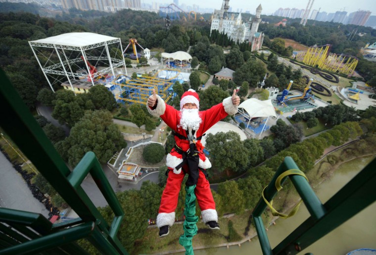 A man dressed up as Santa Claus bungee jumping at a theme park in Changsha, central China's Hunan province. The park organized a series of Santa Claus-themed events ahead of Christmas. (AFP/Getty Images)