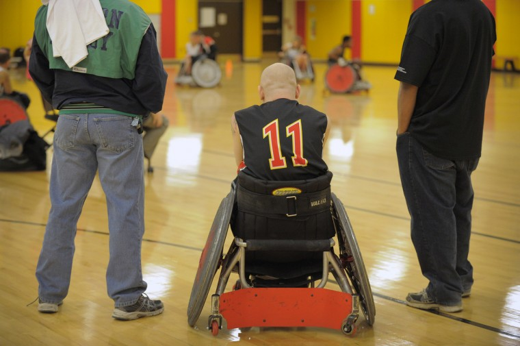 Maryland Mayhem player Shaun Hardester (11) waits for his team's turn to take the court, watching two other teams play during the first Crab Pot Tournament at University of Maryland Rehabilitation & Orthopaedic Institute. (Karl Merton Ferron/Baltimore Sun)
