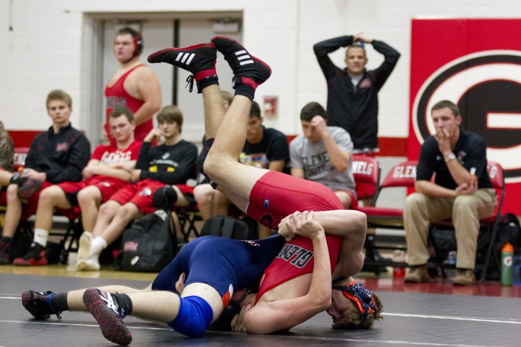 Reservoir's A.J. Strott, left, pinns wrestles Glenelg's Shawn Witschen, right, during the 182-pound wresting match at Glenelg High School in Glenelg, MD on Tuesday, December 9, 2014. (Jen Rynda/BSMG)