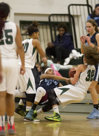Howard's Jayda Gilmore, left, and Atholton's Chelsea Mitchell, right, fight for the ball during the girls basketball game at Atholton High School, MD on Wednesday, December 10, 2014. (Jen Rynda/BSMG)
