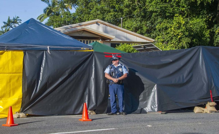 A policeman guards the scene of a stabbing attack at a home in Cairns, northern Queensland, December 19. Eight children have been killed and a woman who was mother to seven of them was injured in the northern Australian city of Cairns, police said on Friday, in what several media outlets reported was a mass stabbing.  || PHOTO CREDIT: STRINGER  - REUTERS