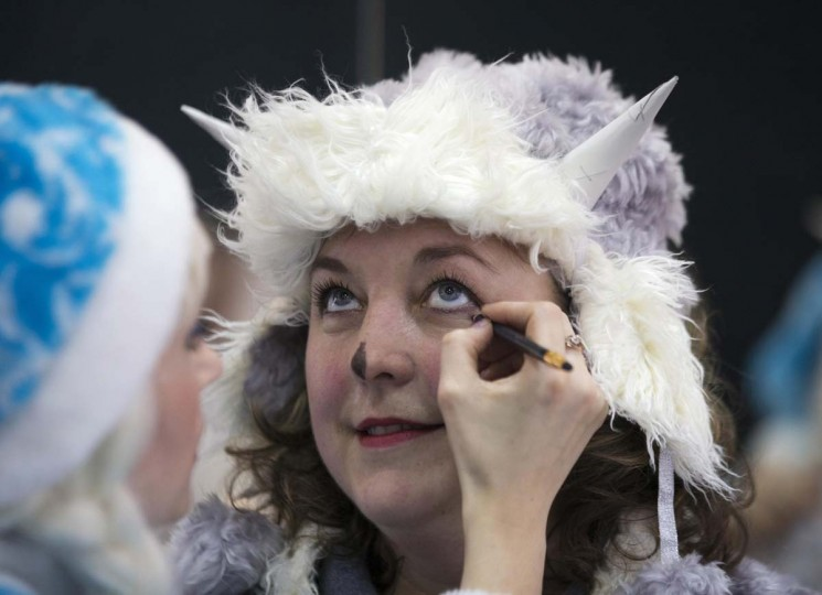 "Women dressed as Snow Maiden prepare themselves for the contest ""Yolka-fest-2014"" (Fir-festival-2014) in Minsk December 12.   