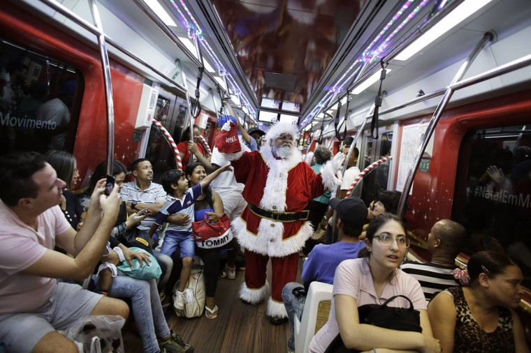 A man, dressed as Santa Claus, rides a subway train as part of a promotional event by a bank in Sao Paulo. (Nacho Doce/Reuters)