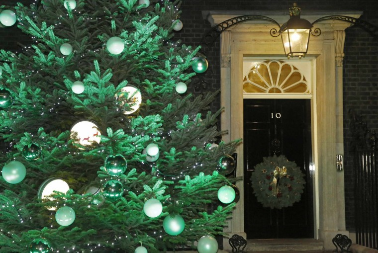 A wreath hangs on 10 Downing Street after the switch on of the Downing Street Christmas lights in London December 8, 2014. (Luke MacGregor/Reuters)