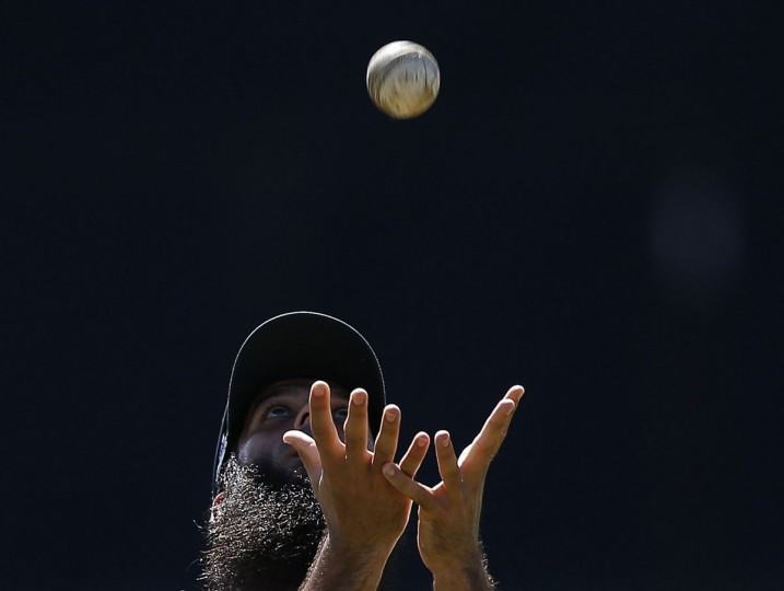 England's Moeen Ali catches a ball during a practice session ahead of their fifth One Day International (ODI) cricket match against Sri Lanka in Pallekele December 9, 2014. (Dinuka Liyanawatte/Reuters)