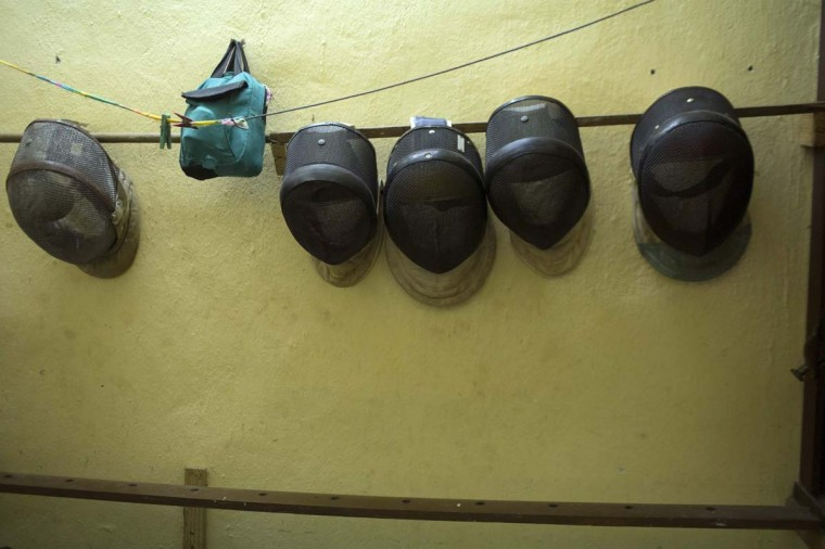 "Fencing masks are seen at the ""Martyrs of Barbados"" fencing gymnasium in downtown Havana, November 26. About 100 students train at the gymnasium, which was named after 73 Cuban fencers, known as the ""Martyrs of Barbados"", who were killed in a 1976 attack when a bomb blew up a Cubana airliner in Barbados. Picture taken November 26, 2014.  