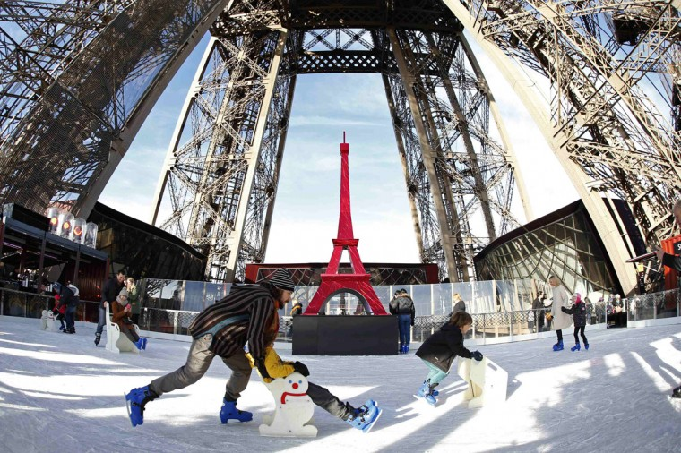 Tourists ice skate on the Eiffel Tower's skating rink in Paris December 9, 2014. The skating rink, located on the first level of the Eiffel Tower, opens to the public as part of the Christmas holiday season. (Charles Platiau/Reuters)