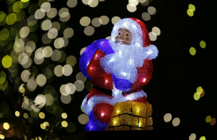 A Santa Claus figure sits on the chimney of a toy house in front of an illuminated house in the town of Stolberg near the western German city of Aachen December 16, 2014. The house is decorated for Christmas with some 200,000 LED lights. Every year hundreds of houses across Germany are decorated by their owners with lights ahead of Christmas. (Wolfgang Rattay/Reuters)