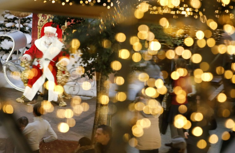 A man dressed as Santa Claus is pictured in a shopping mall decorated with Christmas lights in Berlin, December 19, 2014. (Fabrizio Bensch/Reuters)