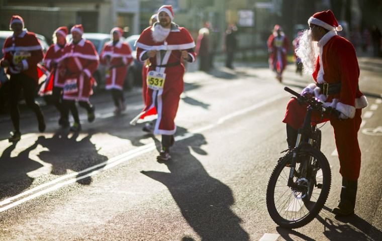 A man dressed as Father Christmas rides a bicycle during the Nikolaus Lauf (Santa Claus Run) in the east German town of Michendorf, southwest of Berlin December 7, 2014. (Hannibal Hanschke/Reuters)