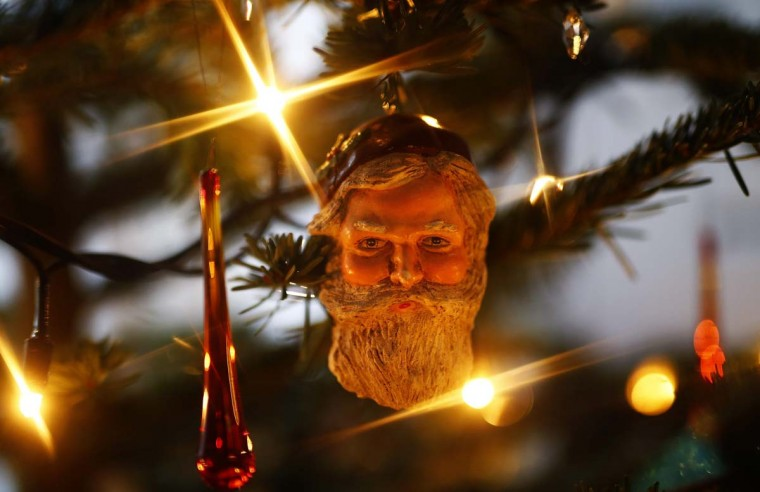 A view shows decorations on a Christmas tree in a house in Hanau December 12.   || PHOTO CREDIT: KAI PFAFFENBACH  - REUTERS