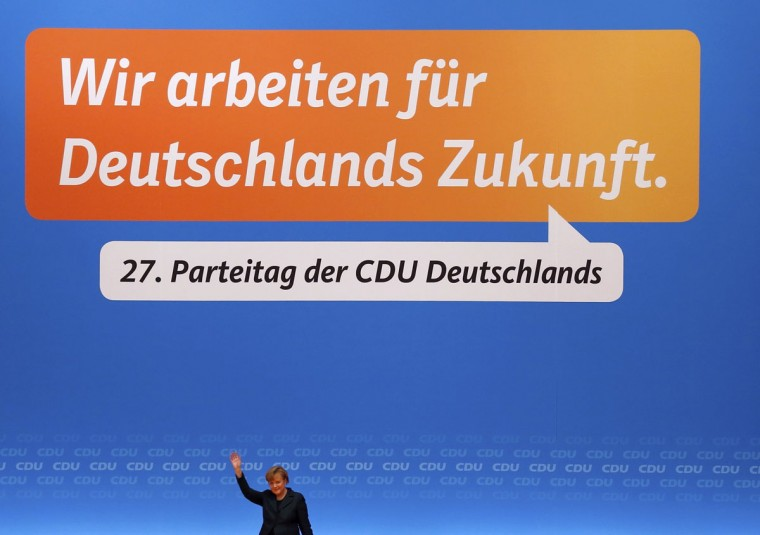 German Chancellor Angela Merkel waves after addressing the Christian Democratic Union (CDU) party convention in Cologne December 9, 2014. The conservative CDU party is holding its 27th party convention from December 8-10.(Wolfgang Rattay/Reuters)