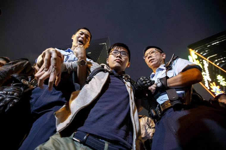 Isabella Lo (L-R), Prince Wong and student leader Joshua Wong speak to journalists during their hunger strike outside the government headquarters in Hong Kong December 2, 2014. Speaking on a stage on Monday night in the heart of the Admiralty protest site next to government headquarters, 18-year-old Wong said they would start a hunger strike to pressure Beijing to grant Hong Kong full democracy. (REUTERS/Bobby Yip)