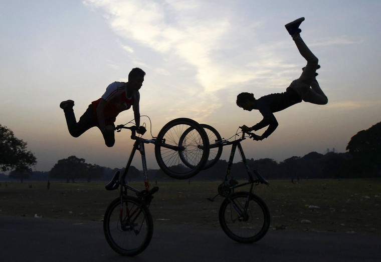 Cyclists perform a stunt as they practice ahead of the Hip-Hop Carnival in Kolkata December 2, 2014. The cyclists will perform in the carnival which be will be held in Kolkata on December 13, the cyclists said. (REUTERS/Rupak De Chowdhuri)