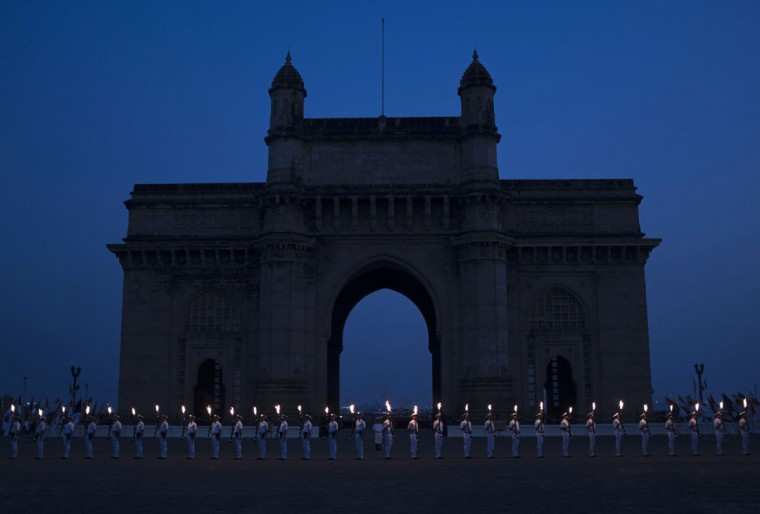 Indian Navy soldiers stand in front of the Gateway of India monument during Navy Day celebrations in Mumbai December 2, 2014. The Indian Navy celebrates Navy Day to commemorate its action at Karachi Harbour during the India-Pakistan war in 1971. (REUTERS/Danish Siddiqui)