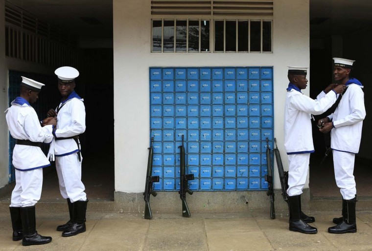 Soldiers from the Kenya Navy prepare their attire shortly before taking part in a military parade during the national celebration to mark Kenya's Jamhuri Day (Independence Day) at the Nyayo Stadium in Nairobi December 12. Kenya marks 51 years of independence from Britain.  || PHOTO CREDIT: NOOR KHAMIS  - REUTERS