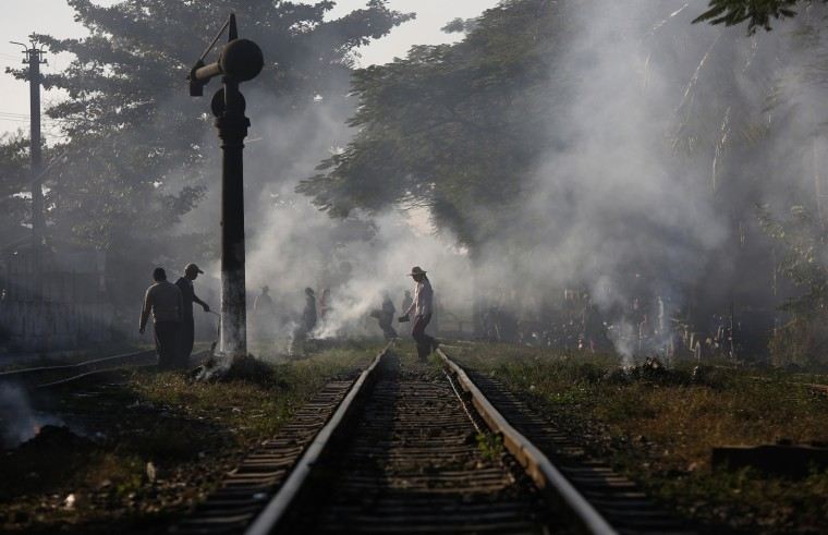 A woman crosses a railway track on her way to a market in Kawlin, Sagaing Division, northern Myanmar December 17, 2014. Picture taken December 17, 2014. REUTERS/Soe Zeya Tun