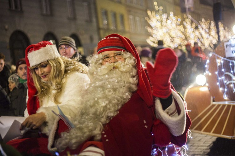 A man dressed like Santa Claus waves as he takes part in a parade during the annual illumination of Christmas lights in Warsaw December 6, 2014. (Bartosz Bobkowski/Agencja Gazeta/Reuters)