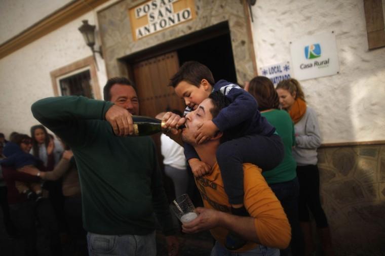Winners of spain s christmas lottery quot el gordo quot celebrate in el gastor