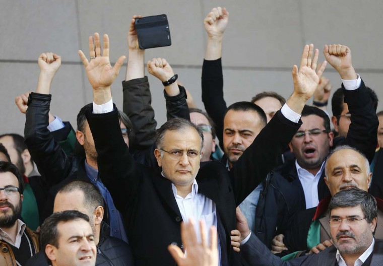 Zaman editor-in-chief Ekrem Dumanli greets his supporters after being released by the court outside the Justice Palace in Istanbul December 19. The European Union, which Turkey is seeking to join, has said last weekend's police raids to detain Karaca and other media workers was contrary to European values, but Erdogan