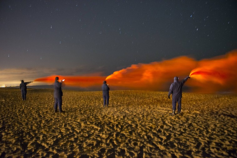 Coast Guard members conduct flare training on Plum Island, Massachussetts December 15, 2014. Picture taken December 15, 2014. REUTERS/U.S. Coast Guard/Petty Officer 3rd Class MyeongHi Clegg/handout