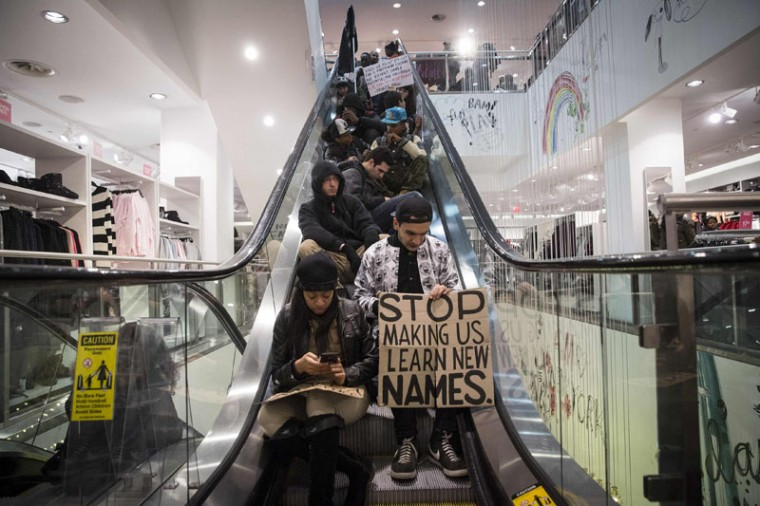 Protesters hold a sit-in on escalators in the 34th Street H&M store, during a march against police violence, in New York. Protesters in New York and other cities staged a fifth night of rallies on Sunday, denouncing use of deadly force by police against minorities. This week's wave of angry but largely peaceful protests began Wednesday when a New York grand jury declined to bring charges against white police officer Daniel Pantaleo in the chokehold death of Garner, a black 43-year-old father of six. (Andrew Kelly/Reuters)