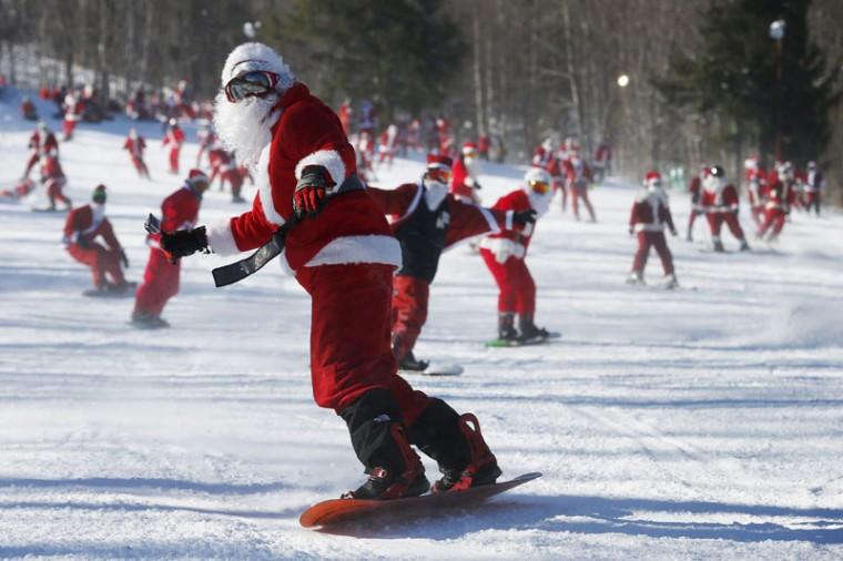 Skiers and snowboarders dressed as Santa Claus participate in a charity run down a slope at Sunday River Ski Resort in Newry, Maine December 7, 2014. Organizers say 250 skiing Santas raised $2700 for charity at the event. (Brian Snyder/Reuters)