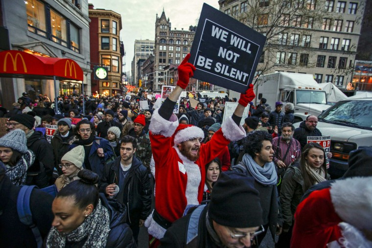 A man dressed as Santa Claus joins protesters in a march against police violence, in Midtown Manhattan, New York December 13, 2014. Thousands marched in Washington, New York and Boston on Saturday to protest killings of unarmed black men by police officers. (Eduardo Munoz/Reuters)