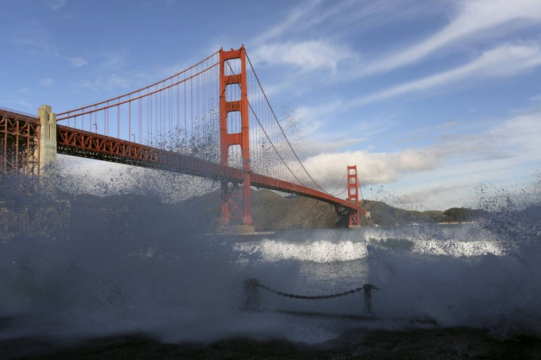 Waves crash against a sea wall in San Francisco Bay beneath the Golden Gate Bridge in San Francisco, California December 16, 2014. A gale warning for offshore winds has been issued through Friday as another round of storms is expected to hit the Bay (REUTERS/Robert Galbraith)