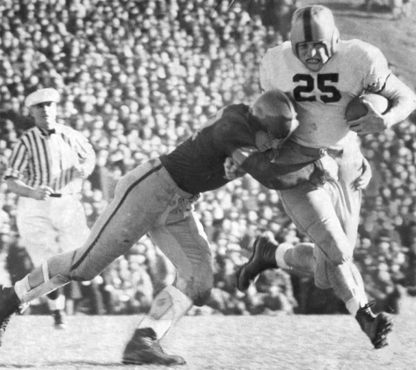 A Navy defender tackles an Army player. (UM Libraries, Special Collections, News American Photo)