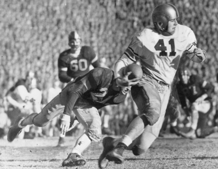 Sometimes called the Gray Phantom of West Point, Glenn Davis (41) picks up 4 yards against Navy. (UM Libraries, Special Collections, News American Photo)