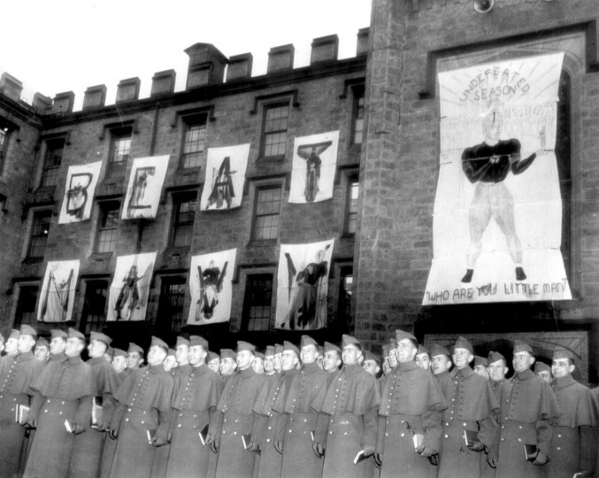 Cadets of the U.S.Military Academy line up beneath signs predicting a win over Navy on Dec. 2, 1944. (Baltimore Sun file photo)