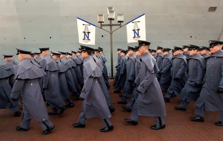During the March On, a parade of cadets march along side the USS Carter Hall in the Inner Harbor on their way to PSI Net Stadium for the Army-Navy football game in 2000. (Baltimore Sun photo by Linda Coan)