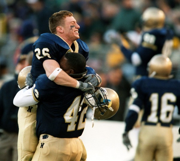 Navy's Chris Lepore is held up by Rashad Jones as they celebrate their win over Army, 30-28. (Baltimore Sun photo by Gene Sweeney Jr.)
