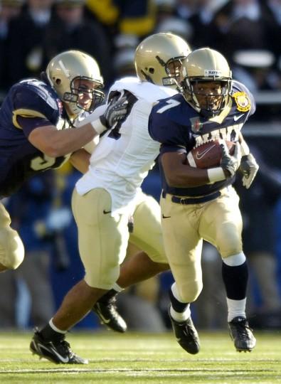 Navy's Reggie Campbell returns a kickoff for a touchdown against Army. (AP Photo/Gail Burton)