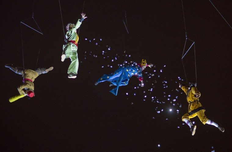 """Artists perform """"Reves de nuit"""" installation about Saint-Exupery by Damien Fontaine during the Festival of Lights in central Lyon December 5, 2014. (REUTERS/Robert Pratta)"""