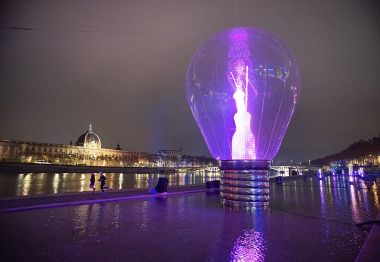 View of a giant incandescent light bulb as part of the Incandescence installation by artist Severine Fontaine during the rehearsal for the Festival of Lights in central Lyon late in the night December 4, 2014. (REUTERS/Robert Pratta)