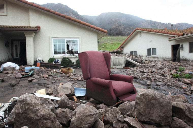 Furniture is seen outside homes that were smashed by debris flows as a powerful storm that has been lashing northern California moves southward on December 12, 2014 (David McNew/Getty Images)