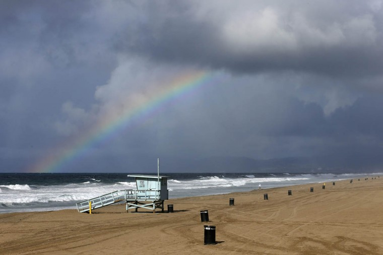 A rainbow is seen from the Manhattan Beach pier during heavy rains in Manhattan Beach, California, December 12, 2014. The National Weather Service forecast the system to track through southwestern California late on Thursday and into Friday, bringing the possibility of strong thunderstorms, as well as waterspouts and small tornadoes along the coast. (Patrick T. Fallon/Reuters photo)