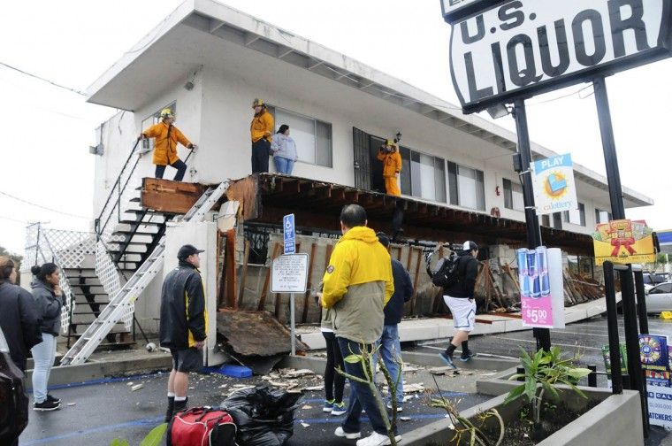 A second-story walkway to apartment units is shown after it collapsed during heavy rains in Long Beach, California, December 12, 2014. A major storm that pummeled northern California and the Pacific Northwest with heavy rain and high winds and killed two people moved south overnight, prompting evacuation orders in areas prone to floods and mud flows. The National Weather Service forecast the system to track through southwestern California late on Thursday and into Friday, bringing the possibility of strong thunderstorms, as well as waterspouts and small tornadoes along the coast. (Bob Riha Jr./Reuters photo)