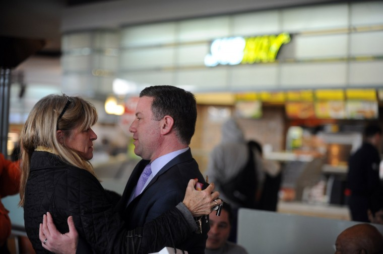 "County executive Ken Ulman, right, is embraced by Mary Ellen Baker, manager at Belmont Manor and Historic Park, as she came to support his as the Mall in Columbia reopened on Monday, Jan 27. Baker said she was ""comforted by the fact that he's in charge."" (Brian Krista/BSMG)"