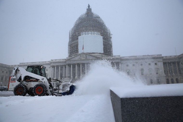 Clearing a path for the new Congress, employees of the Architect of the Capitol use tractors to remove snow from in front of the U.S. Capitol as more snow continues to fall January 6, 2015 in Washington, DC. Tuesday is the opening day of the 114th Congress. (Photo by Chip Somodevilla/Getty Images)