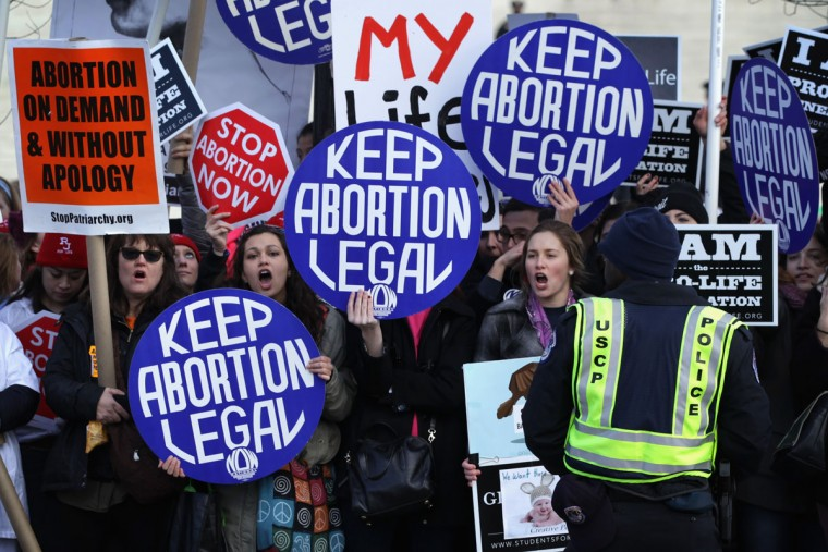 Pro-choice activists shout slogans before the annual March for Life passes by the U.S. Supreme Court January 22, 2015 in Washington, DC. (Photo by Alex Wong/Getty Images)