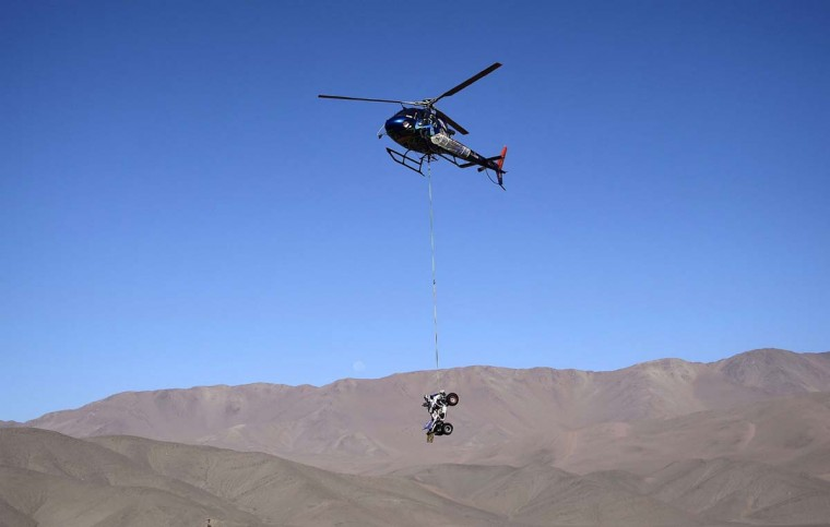 A helicopter lifts a quad before the Stage 5 of the Dakar 2015 between Copiapo and Antofogasta, Chile, on January 8. FRANCK FIFEFRANCK FIFE - AFP/GETTY IMAGES