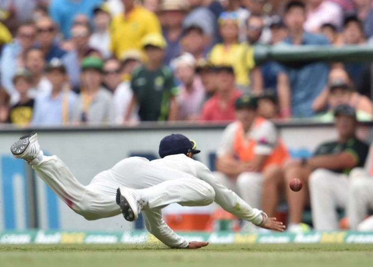 India's captain Virat Kohli dives to save a boundary during day four of the fourth cricket Test between Australia and India at the Sydney Cricket Ground (SCG) on January 9, 2015.     || CREDIT: PETER PARKS - AFP/GETTY IMAGES